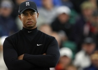 US golfer Tiger Woods stands on the 14th