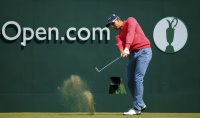 Henrik Stenson of Sweden tees off on the first hole during the final round of the British Open golf Championship at Muirfield in Scotland