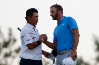 OAKMONT, PA - JUNE 17: Hideki Matsuyama of Japan greets Dustin Johnson of the United States following the completion of the second round of the U.S. Open at Oakmont Country Club on June 17, 2016 in Oakmont, Pennsylvania. (Photo by Christian Petersen/Getty Images)